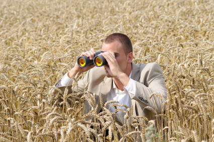 agent of secret service watching through binoculars in the field